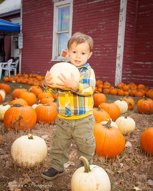 Miners-Pumpkin-Patch-kid-with-pumpkin