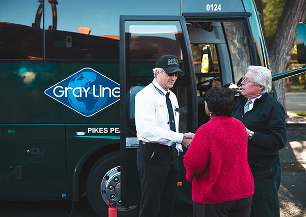 Gray line tour guide shaking hands