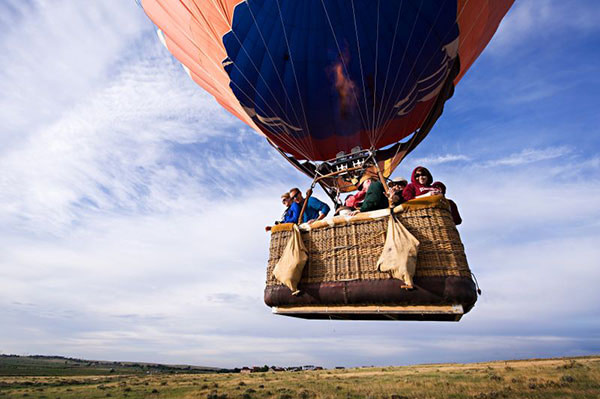 adventures out west balloon tour people in basket