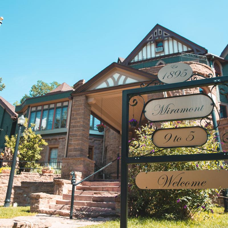 miramont castle entrance sign